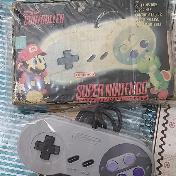 Controle super nintendo original, na caixa original.
