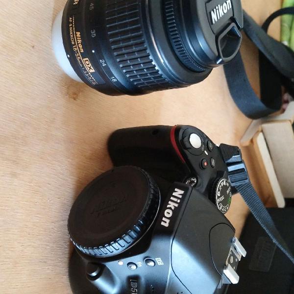 Nikon d5100 + lente 18-55mm + carregador bateria câmera +