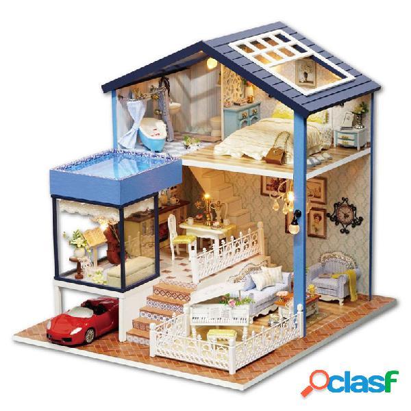 Modelo diminuto da casa de boneca de seattle diy com as decorações claras da sala da música