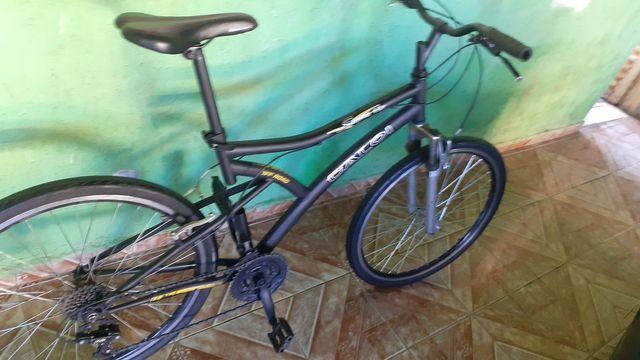 Bicicle caloi com suspensão e rodas aero cubo de rolamento