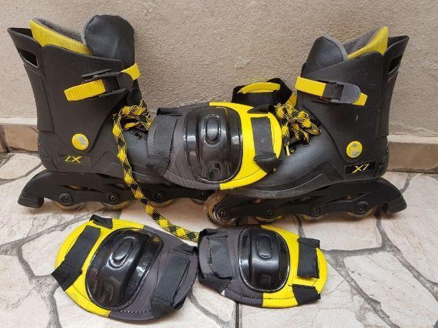 Patins usado cor preto com amarela a companha joelheira e