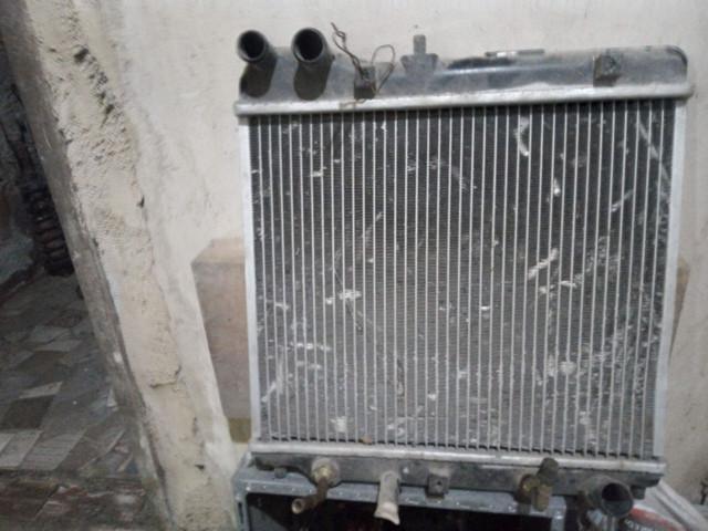 Alternador e radiador Honda.