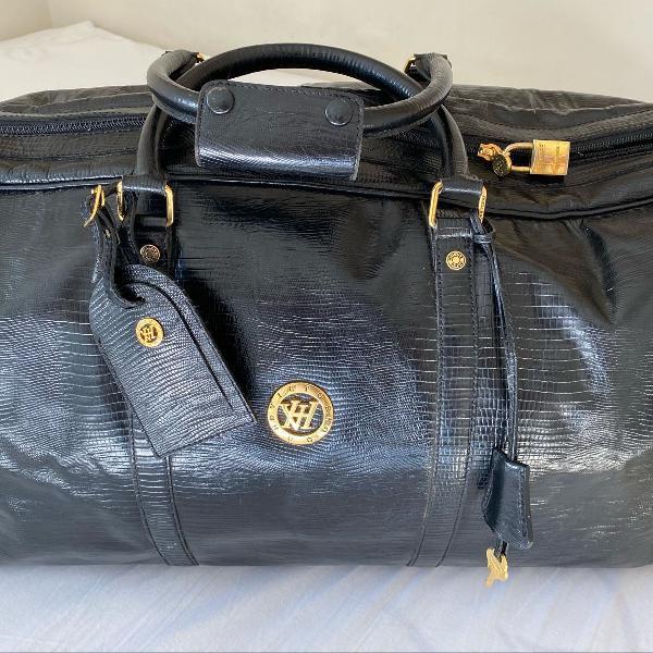 Bolsa de mão para viagem em couro marca vitor hugo