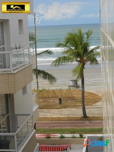 Kitnet em prédio frente praia e kit com vista parcial da praia com garagem