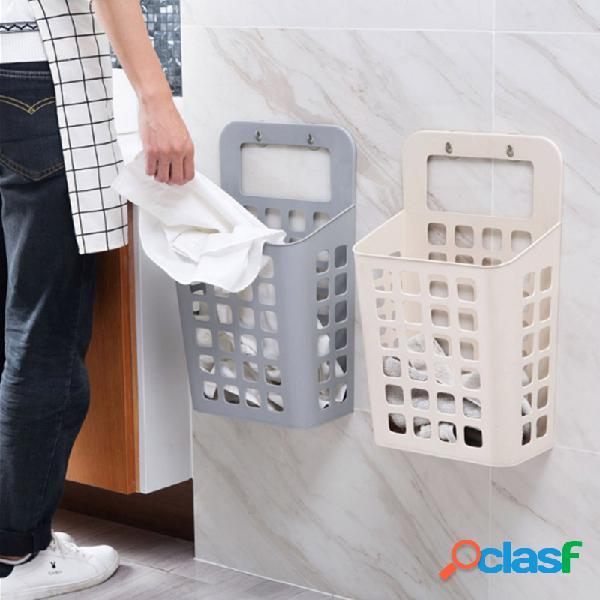 Ventosa para roupas sujas pendurado no cesto de armazenamento