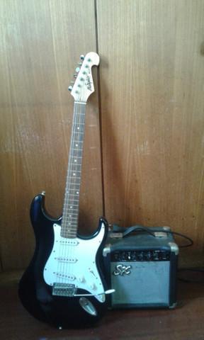 Guitarra memphis mg22 e amplificador ga 1065