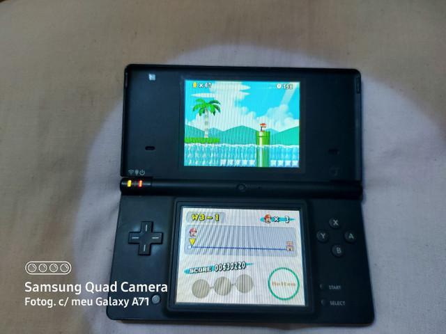 Nintendo ds. carregador original + 4 jogos.