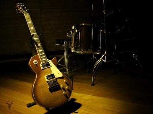 Aulas de guitarra - monte seu repertório/toque em 6 meses!