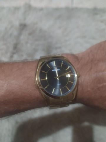 Relógio masculino orient dourado original