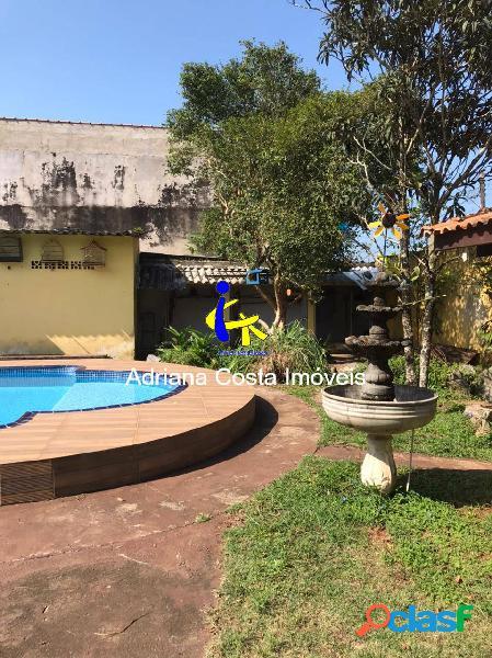 Casa 5 dormitórios jardim amplo com fonte e piscina em mongaguá