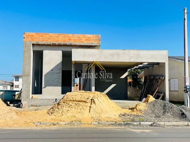 Casa nova no centro da praia