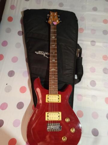 Guitarra t.jhonson/cubo sheldon gt 1200